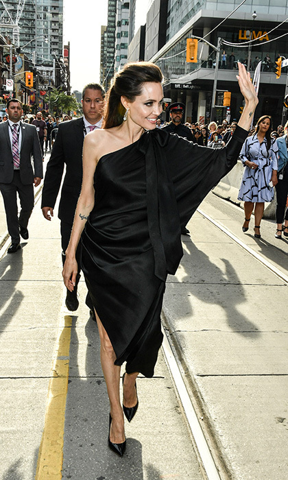 Angelina Jolie looked stunning in Ralph and Russo as she arrived for the screening of First They Killed My Father at Princess of Wales Theatre on September 11.