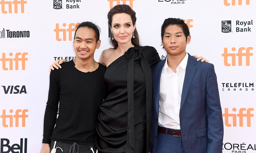Angelina, who was joined by all of her and Brad Pitt's six kids at the screening, also stopped to share the spotlight just with her two oldest sons, 16-year-old Maddox, left and Pax,13.