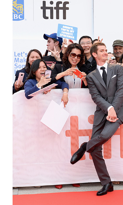 "Fans held ""You're my favorite Spiderman"" signs as Andrew Garfield mingled with the crowd at the premiere of Breathe. 