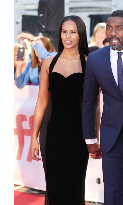 <p>Idris Elba wasn't alone when he walked the red carpet at the premiere of Molly's Game and The Mountain Between Us. The handsome Hollywood star walked hand-in-hand with his gorgeous model girlfriend Sabrina Dhowre.</p><p>The former Miss Vancouver winner stunned the crowd in a sleek and sophisticated black floor-length gown, while her partner donned a simple navy blue suit. The two were all smiles as they posed for photos and greeted fans on the carpet.</p><p>The 29-year-old Somalia-born beauty has reportedly been dating Idris for the past six months. Though the 45-year-old typically keep his relationships hush-hush, Sabrina has been posting photos of the star all over her Snapchat.</p>