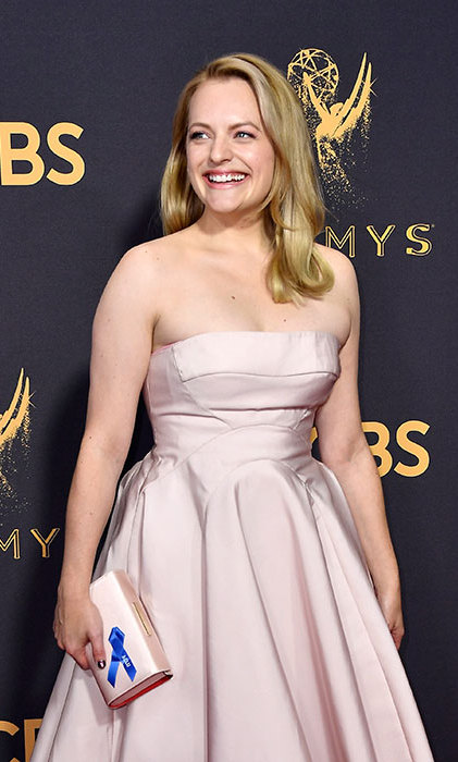 <p>It seems Hollywood is still trying to make a political point! On Sunday, several stars came out in full force for this year's Emmy Awards wearing blue ribbons in support of the American Civil Liberties Union (ACLU). Elizabeth Moss made sure she donned their blue ribbon with pride at the 69th annual award show.</p>