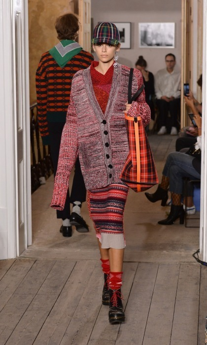 <p>The three models watched Kaia Gerber walk the runway in London for the first time.</p>