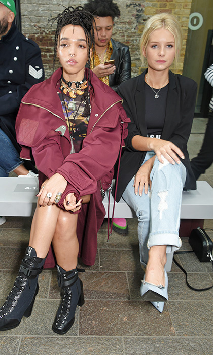 </p>FKA Twigs, left, and Kate Moss' sister Lottie Moss sat front row for the Versus SS18 catwalk show.</p>