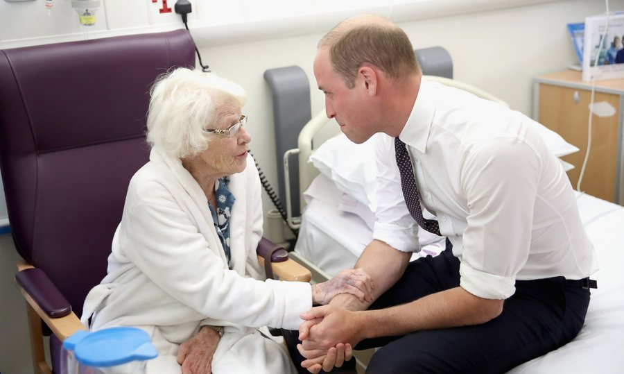 <p>Prince William demonstrated he has inherited mom Princess Diana's special touch while speaking with Theresa Jones in the Frailty unit during a visit to Aintree University Hospital on September 14 in Liverpool, England. </p>