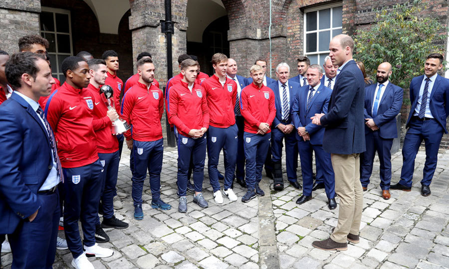<p>After dropping his son off at his first day of school, Prince William hosted a reception for the Under-20 England soccer team at Kensington Palace.<p>