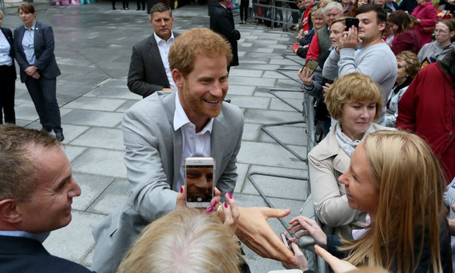<p>That's some close up! Prince Harry was greeted by fans and phones as he visited Cathedral quarter in Belfast during his first trip to Northern Ireland on September 7.</p>