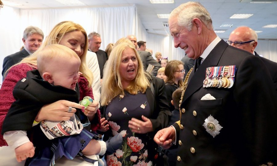<p>Prince Charles – styled as the Duke of Rothesay while in Scotland – seemed to empathize with shy 11-month-old Myles Johnston at a reception following the official naming ceremony of aircraft carrier HMS Prince of Wales in Fife.</p>