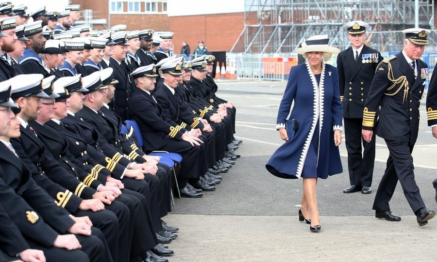 <p>Duchess Camilla had the attention of the sailors after posing for a group photograph at the naming ceremony of the HMS Prince of Wales at the Royal Dockyard in Fife, Scotland. </p>