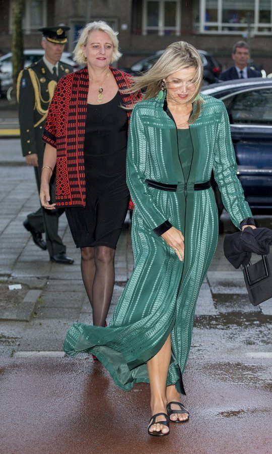 <p>Wearing flat sandals in the rainy weather, Queen Maxima of the Netherlands nearly got swept away by pre-autumn winds at the LOEY awards in Amsterdam on September 11. </p>