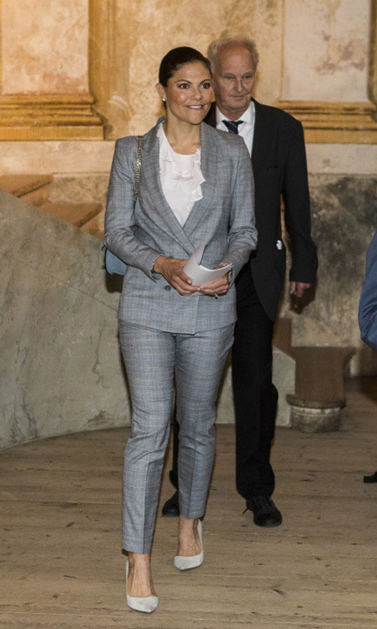 <p>Crown Princess Victoria was all business in a grey suit while attending the Royal Colloquium 25th anniversary celebrations at Ulriksdal Palace Theatre on September 6.<p>