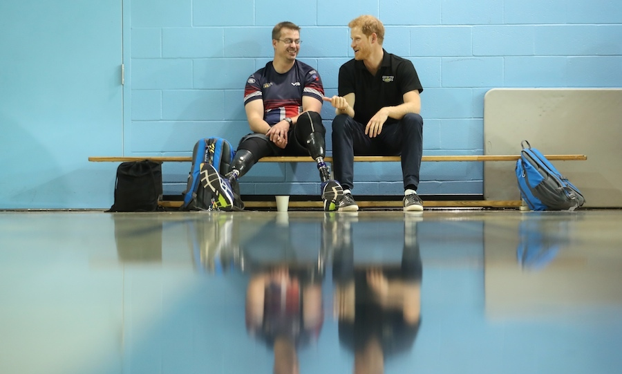 Prince Harry talked strategy with UK team member Charlie Walker during a training session at the Pan Am Sports Centre.