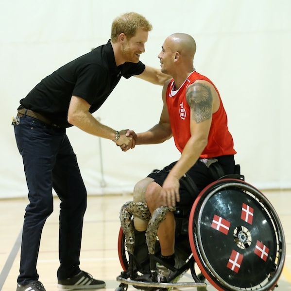 Harry delivered some words of encouragement to a member of Denmark's team during a training session on the eve of the Games.