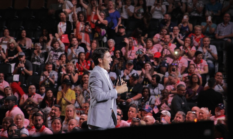 "In a spirited speech, the PM applauded the athletes for continuing to ""serve their country with passion and integrity.""