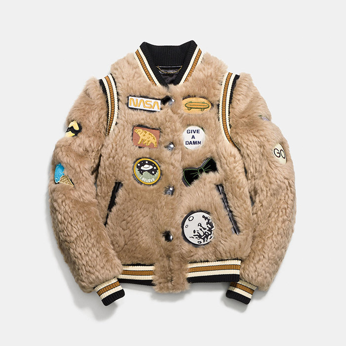 <p><strong>Shearling Varsity Jacket With Patches</strong>, $2,500, <em>coach.com</em></p>
