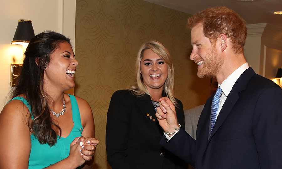 Part of Harry's royal duties while in Toronto included meeting The Duke Edinburgh's International Gold Award winners Jessica Silva (L) and Augusta White. 