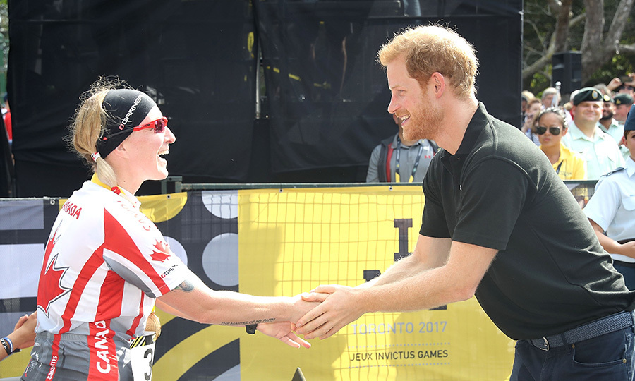 Prince Harry congratulates Julie Marcotte on winning gold. 