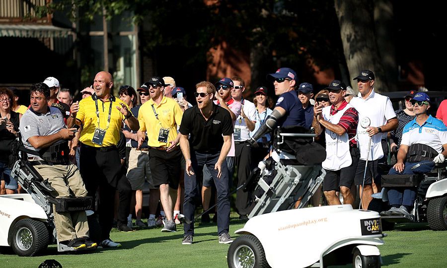 On Tuesday (Sept. 26) afternoon, Prince Harry checked out all the action on the green at St. George's Golf Club. It's the first time golf has been played at the Invictus Games. 