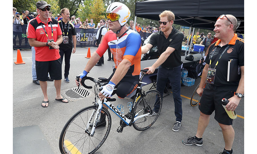 Helpful Harry gives a Dutch competitor a hand at the starting line of the Cycling Time Trial on Tuesday (Sept. 26) in High Park. 