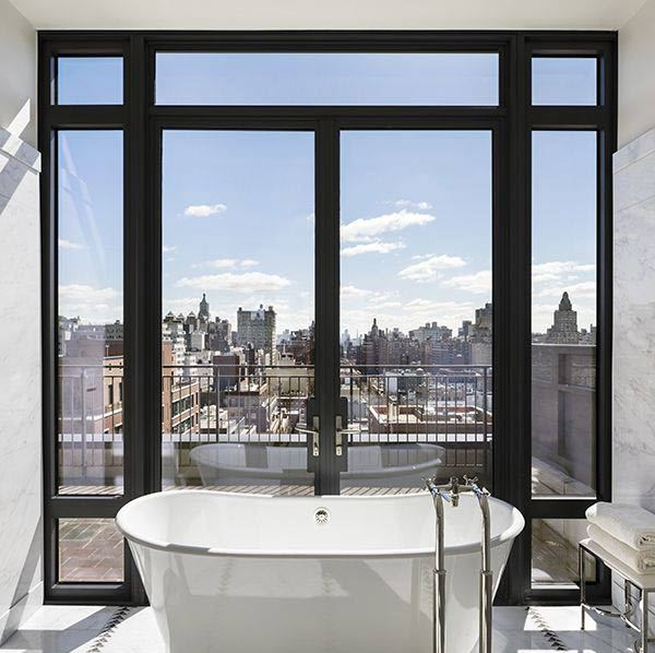 <p>The master suite is one of the highlights of Jon Bon Jovi's new home, with floor-to-ceiling windows, a walk-in wardrobe and this marble master bathroom, which has heated floors, a glass-enclosed shower and this incredible bathtub, which offers insane views over the Manhattan skyline!</p>