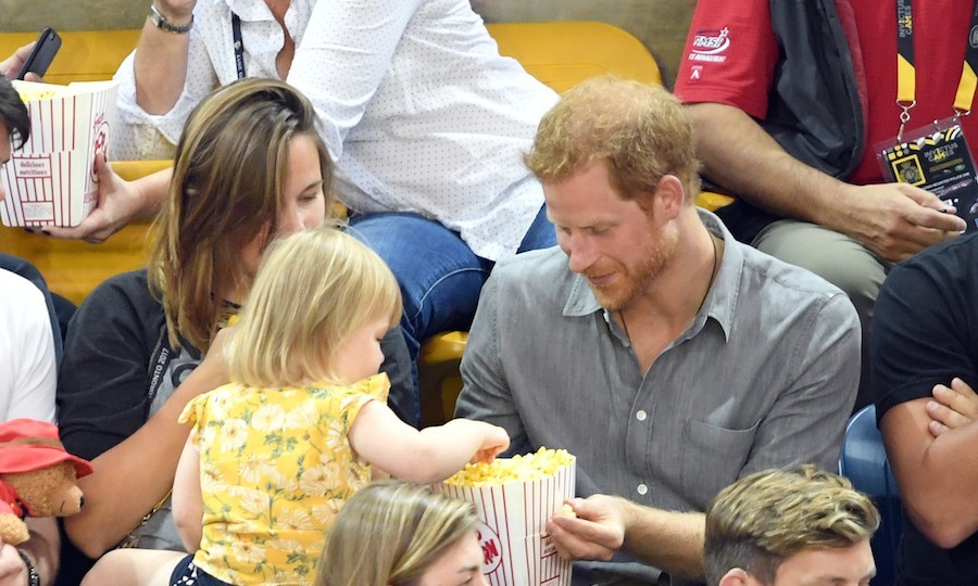 Sharing is caring! Prince Harry and Emily enjoyed snack time while watching the teams face off in the semi-final of sitting volleyball.