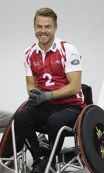 World of Dance star Derek Hough is all smiles as he prepares to play in the Jaguar/Land Rover Celebrity Wheelchair Rugby game. He faced off against stars like celebrity chef Robert Irvine. 