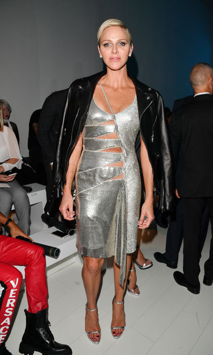 <p>Princess Charlene of Monaco turned heads in a daring silver dress at the Versace show during Milan Fashion Week. </p>