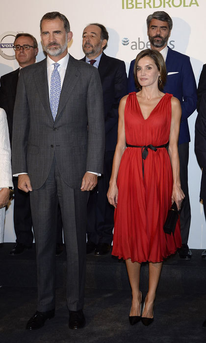 <p>Letizia of Spain was the lady in red as she stepped out wearing a pleated Carolina Herrera dress to Vocento's 15th anniversary celebration held at Madrid's Royal Theatre. </p>
