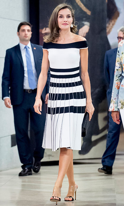 <p>Queen Letizia donned this off-the-shoulder dress and transparent shoes at the 'Esmo 2017' conference in Madrid on September 7.</p>