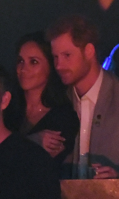 The lovebirds were in their own little world as they watched The Boss perform. Shortly after, Harry headed to the stage to officially close the games. 