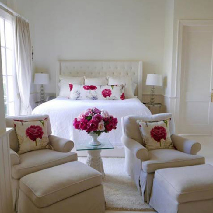 "<p>Another of Catherine and Michael's guest rooms has been decorated in a cream and neutral colour scheme with bright pink flowers and floral print cushions adding a pop of colour to the room. ""Guest room. Simply inspired by those beautiful pink flowers,"" Catherine captioned this photo in February.</p>