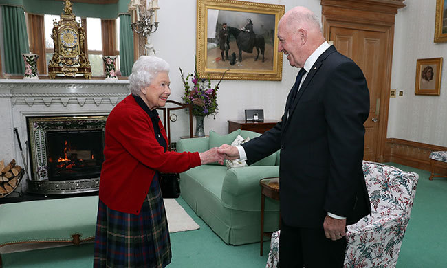 A silver class iPod is seen in the background of the Queen's living room in Balmoral Castle