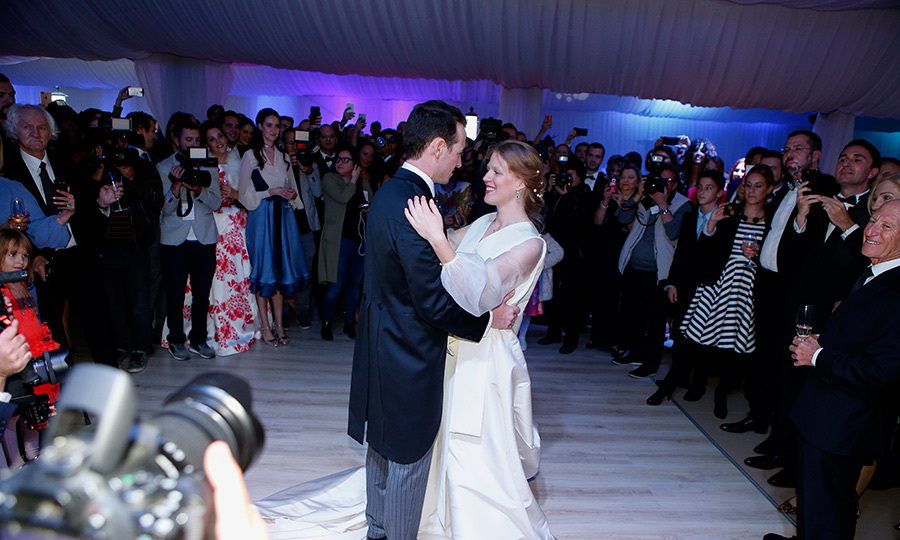 <p>The bride and groom enjoy their first dance.</p>