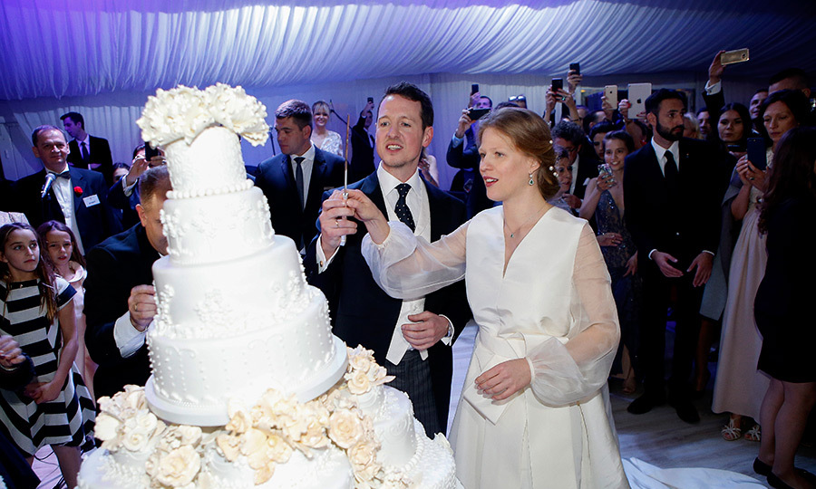 Guests gathered around to watch Philip and Danica cut their six-tiered wedding cake. 