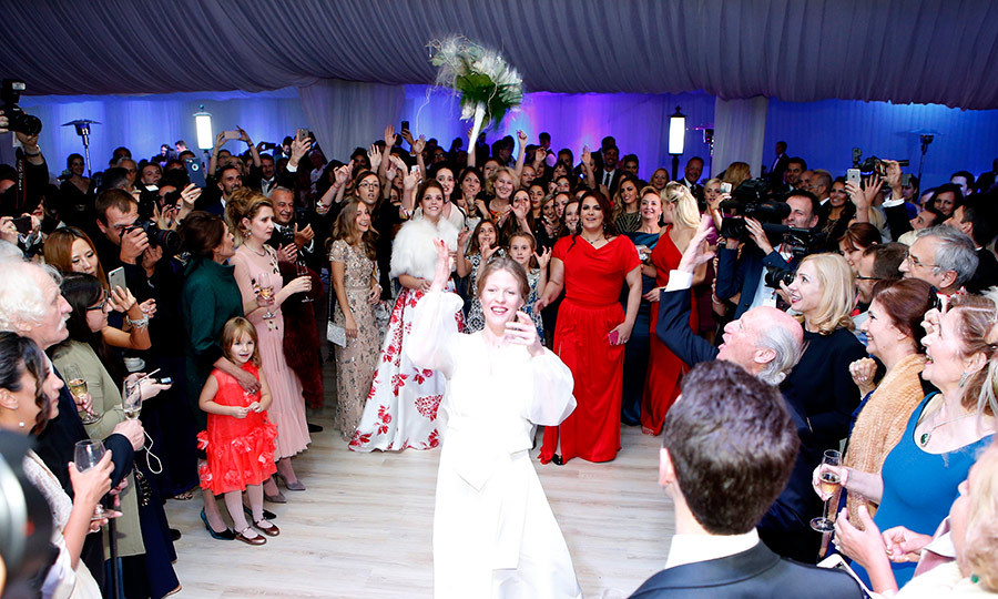 At the reception, guests were treated to traditional dance performances, live music, speeches and the wedding bouquet toss.</p>