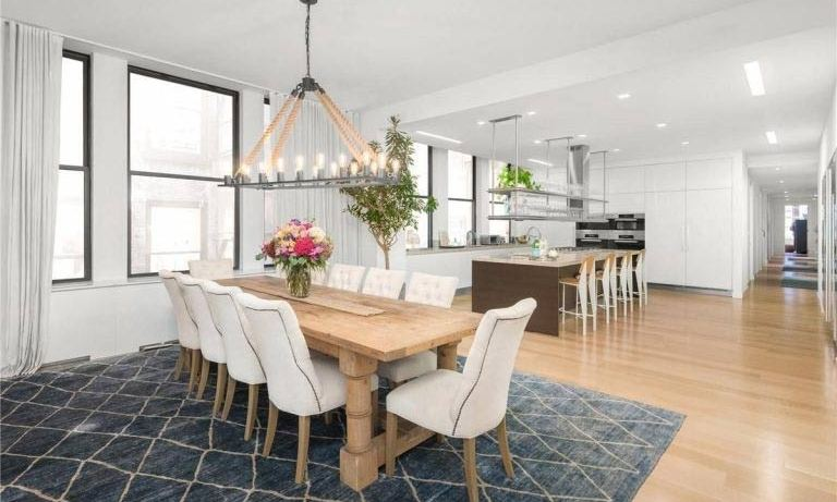 <p>There is a large dining table with seating for ten people adjacent to the kitchen, where Jennifer would be able to cook family meals for her twins Max and Emme, and boyfriend Alex Rodriguez. The room is decorated in clean white and grey tones, with a unique light fixture suspended over the dining table.</p>