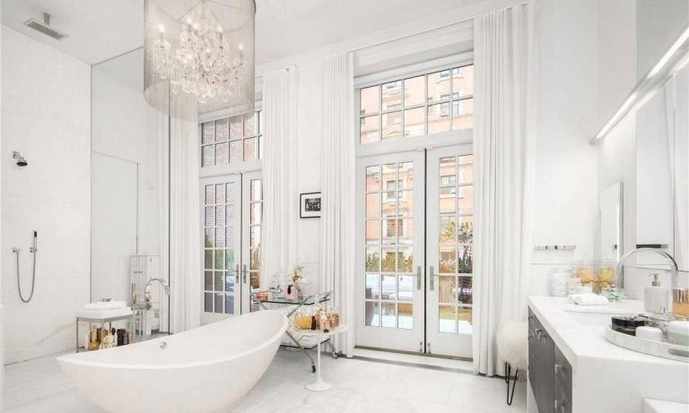 <p>The bathrooms are fitted with Italian marble slab tiling, and this opulent suite features a curved white bathtub at the centre of the room. There is also a monsoon-style shower area and marble dresser, where Jennifer would be able to get ready for her red carpet events.</p>