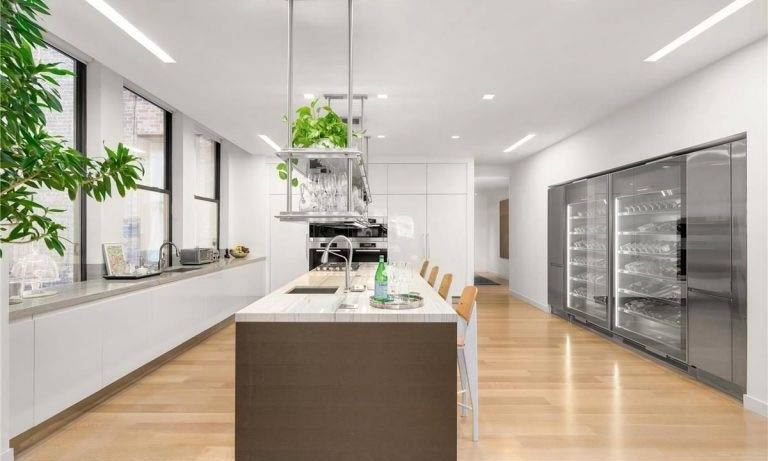 <p>The kitchen is fitted with the ultimate in luxury finishes, with Miele and Sub-Zero appliances and sleek white Arclinea custom kitchen cabinets. With a huge wine fridge and a central island unit lined with four stalls, it appears to be an ideal spot to entertain friends and family.</p>