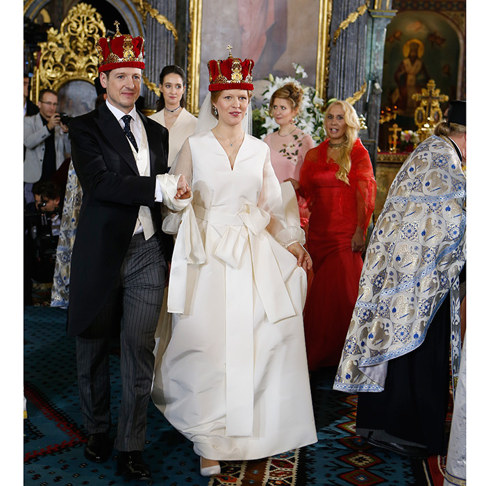 <p>It was time for a royal wedding in Belgrade as Prince Philip of Serbia tied the knot with his love Danica Marinkovic at the Cathedral Church of St. Michael the Archangel on October 7. Danica was the picture of happiness in a full-length silk princess gown that featured billowy sheer long sleeves, an oversized bow sash at the waist and a sweeping train. <br /><br />Photo by Milica Radicevic/WireImage</p>