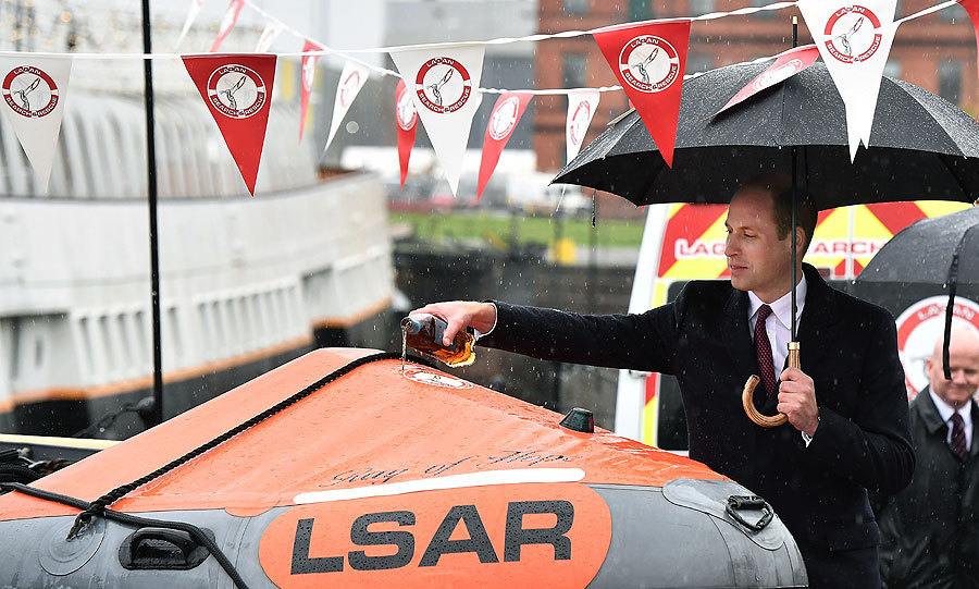 "<p>On day one of his trip to Belfast, Northern Ireland, <a href=""/tags/0/monaco-royals/"">Prince William</a> was tasked with naming a new lifeboat. The British royal poured a measure of whiskey onto <em>Ray of Hope</em> during the ceremony while visiting the headquarters of the Lagan Search and Rescue service, who patrol the waters of the River Lagan.<br /><br />Photo: Getty Images</p>"