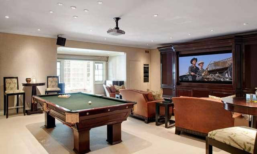 <p>James' new home features a basement media room and gym which opens out onto the huge gardens. A great place for James to unwind or come up with ideas for his popular talk show, the room is fitted with a large flat screen TV and leather armchairs, two bar tables and a snooker table.</p>