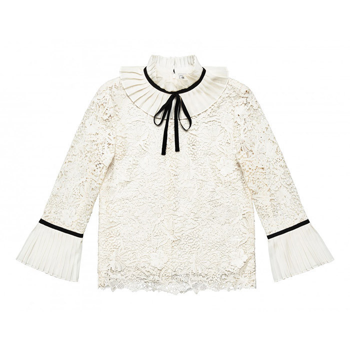 <p>This modest white blouse with black ribbon detail and bracelet sleeves would look right at home at the palace, but is versatile enough that it can be paired with a number of pieces, from a ladylike skirt to distressed jeans.<br/><br/>Blouse, $129<br/><br/>Photo: Erdem x H&M</p>