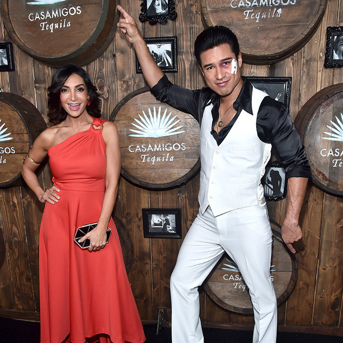 Courtney Mazza and Mario Lopez showed off their love for <em>Saturday Night Fever</em> at the Casamigos Halloween Party in 2016.