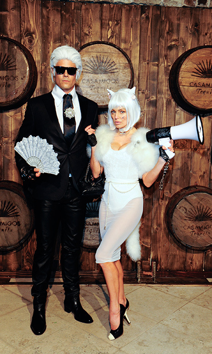 Before their separation in 2017, Josh Duhamel and Fergie were the king and queen of couple costumes. Here they win all the awards as Chanel's Karl Lagerfeld and his beloved cat Choupette. 