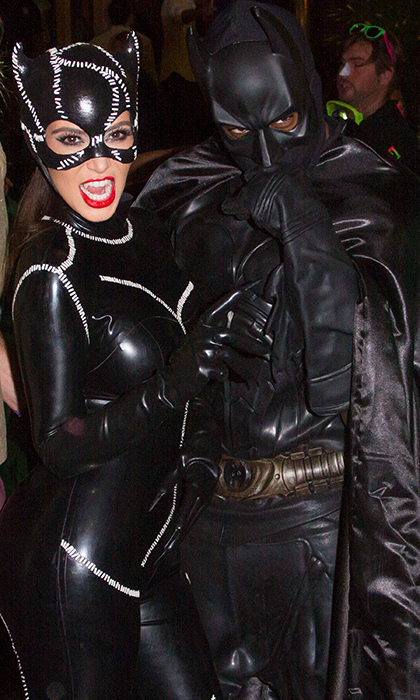 Batman and Catwoman take Miami! Kim Kardashian and Kanye West were the ultimate masked duo in 2012. 
