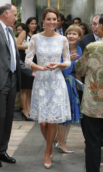<p>Kate stepped out in a blue dress with a floral lace overlay for a Diamond Jubilee tea party during her 2012 tour of Asia.<br /><br />Photo: Danny Lawson - Pool/Getty Images</p>