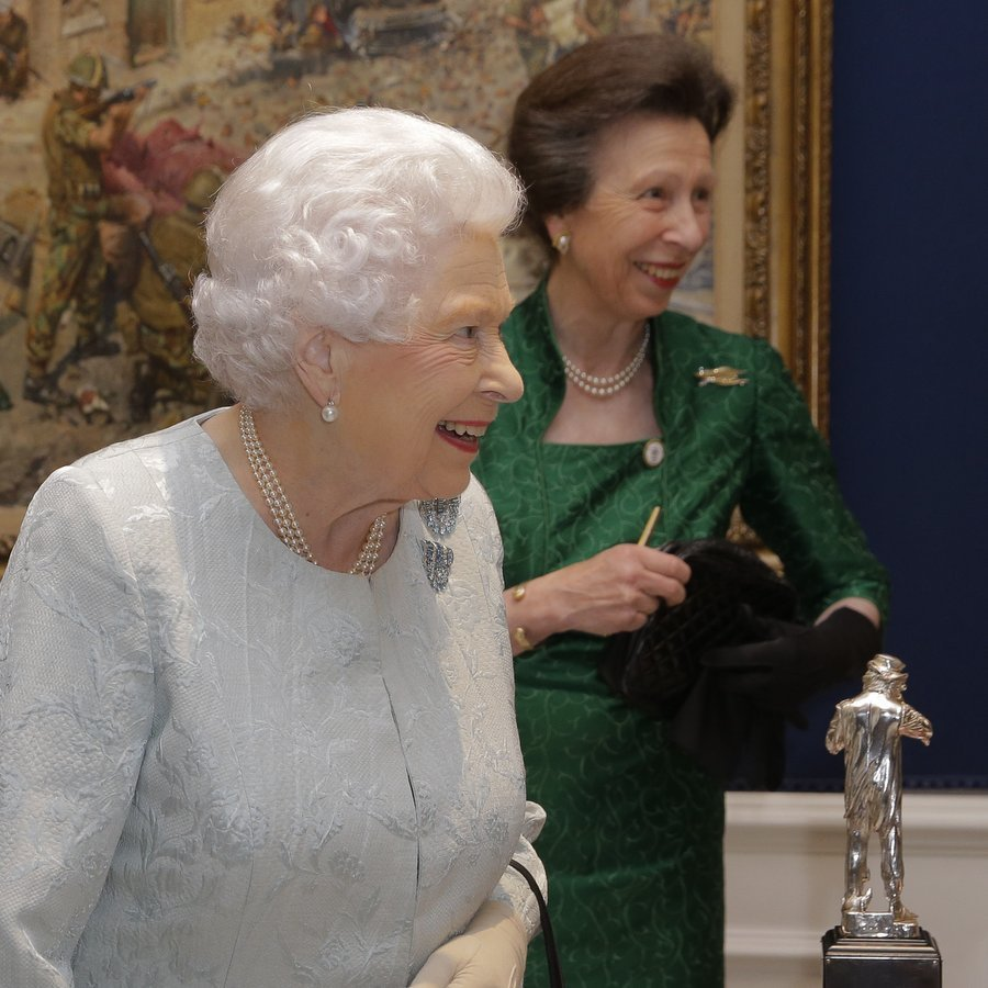 We certainly can't resist a mother-daughter team – especially when it comes to royals! An elegant Queen Elizabeth II was joined by her only daughter Princess Anne for a reception to celebrate the Women's Royal Naval Service 100 project at The Army and Navy Club on October 12 in London, England. 