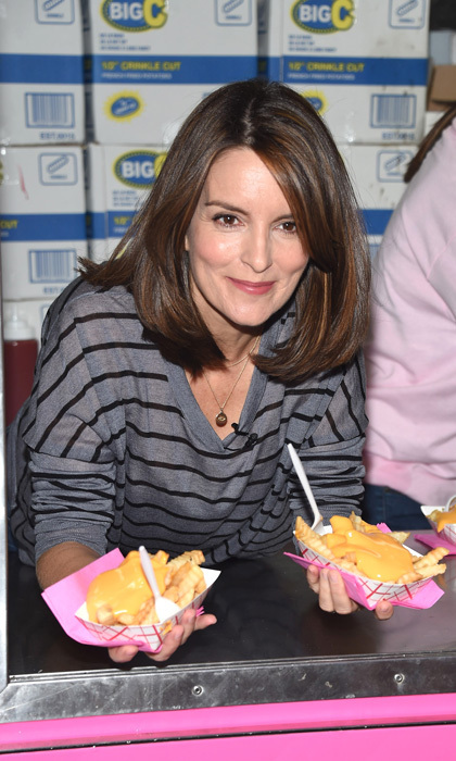 <p>Tina Fey hooked fans up with cheese fries during the celebration of <em>Mean Girls</em> on Broadway at the August Wilson Theatre.<br /><br />Photo: Gary Gershoff/Getty Images</p>