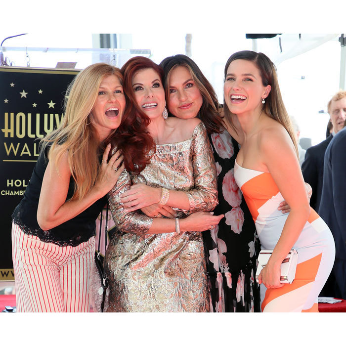 "<p>Debra Messing was surrounded by some of her closest friends including Connie Britton, Mariska Hargitay and Sophie Bush when she received her star on the Hollywood Walk of Fame. <br /><br />The <em>Will &amp; Grace</em> actress reminisced on her first trip to L.A. during the ceremony. ""I think back to when my parents brought my brother and me to Hollywood the for the first time,"" she said, according to ABC7. ""Of course, we went to Universal Studios and Grauman's Chinese Theater. The Wizard of Oz was my favorite movie and I couldn't believe that [I] was able to put my hand in Judy Garland's hand print. It felt like I had touched her. I smiled all the way back to Rhode Island.""<br /><br />Photo: Getty Images</p>"
