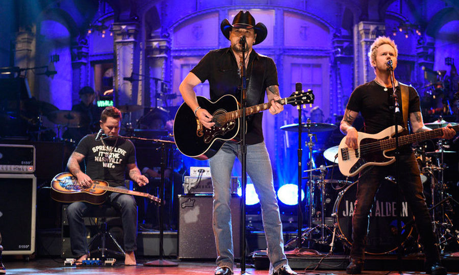 "<p>Nearly a week after the mass shooting in Las Vegas, Jason Aldean returned to the stage once again during <em>Saturday Night Live</em>. The country singer, who was mid-performance during the Route 91 Harvest Festival at the time of the shooting, opened the show with a tribute for the victims as well as Tom Petty by performing the late singer's <em>I Won't Back Down</em>.<br /><br />The dad-of-two with another on the way said, ""This week we witnessed one of the worst tragedies in American history. Like everyone, I'm struggling to understand what happened that night and how to pick up the pieces and start to heal. So many people are hurting. There are children, parents, brothers, sisters, friends. They're all part of our family. So I want to say to them, we hurt for you and we hurt with you, and you can be sure we're going to walk through these tough times together, every step of the way. Because when America is at its best, our bond and our spirit, it's unbreakable.""<br /><br />Photo: Will Heath/NBC</p>"