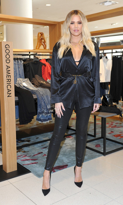 <p>Khloe Kardashian made her first public appearance since the pregnancy news hit on October 7. The <em>Good American</em> fashion founder visited Nordstrom in Century City to promote the line's latest collection. For the outing, she paired a satin low-cut shirt with black pants and pumps. <br /><br />Photo: Getty Images</p>